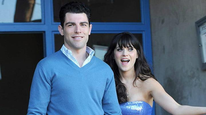 une femme souriant avec la bouche ouverte et un homme souriant